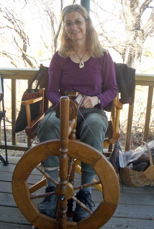 Christine spinning wool yarn on her Louet spinning wheel.