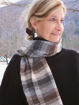 Christine wearing one of her alpaca scarves.