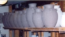 Jomon vases drying on shelves.