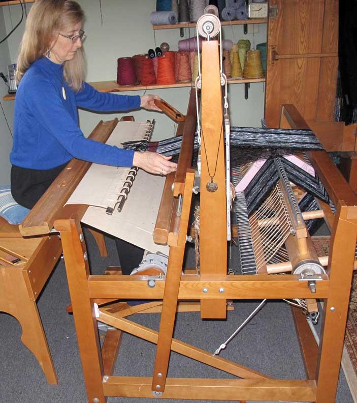 Weaving on her LeClerc loom.