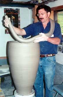 Robert working on coil built urn.