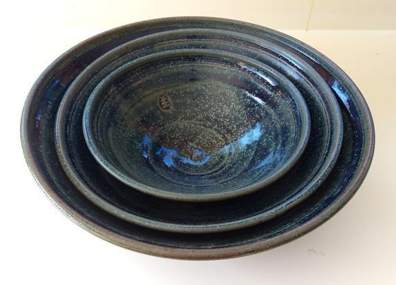 Set of 3 blue stacking bowls.