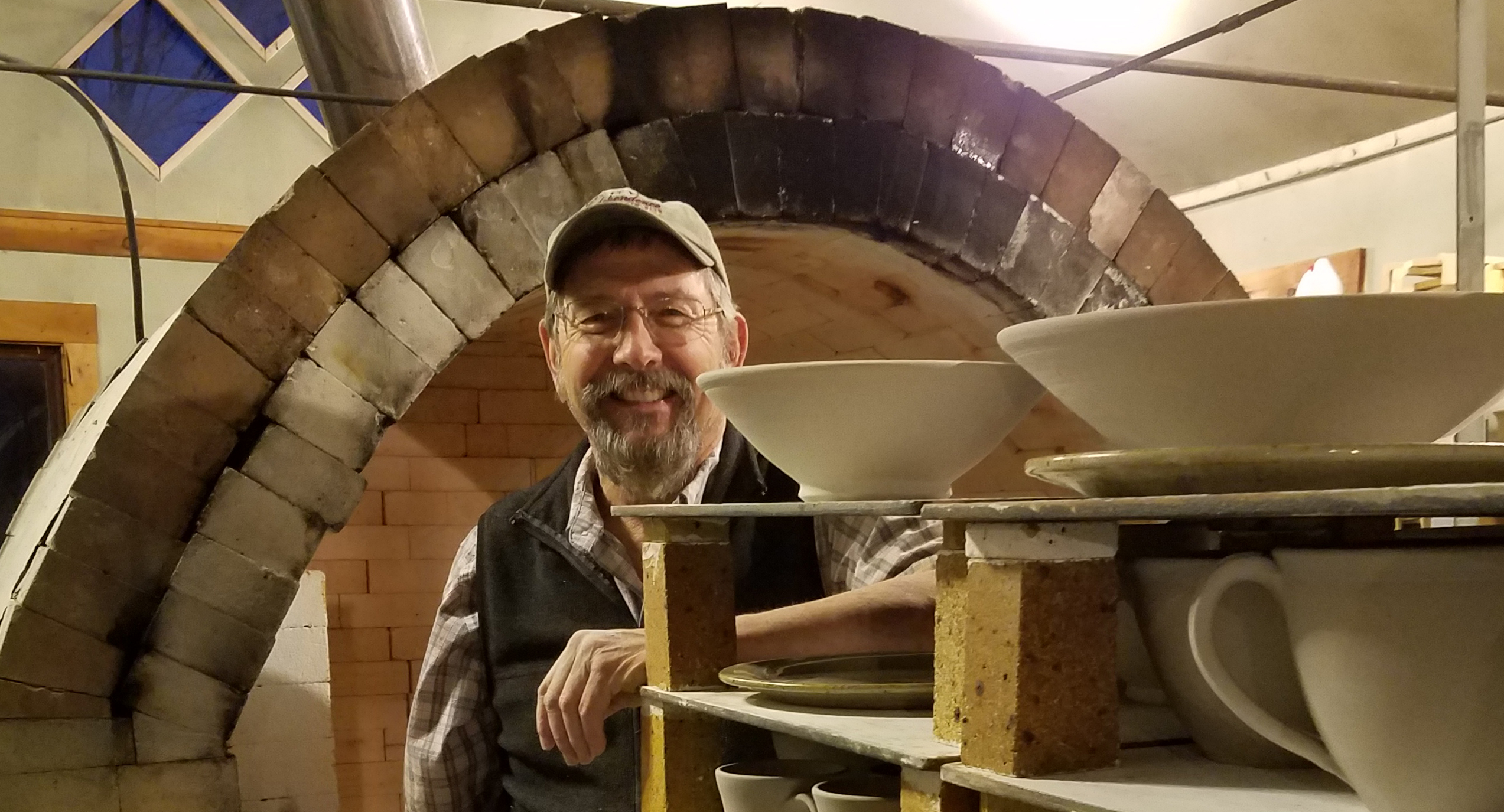 "Robert loading his gas fired ""reduction"" kiln."